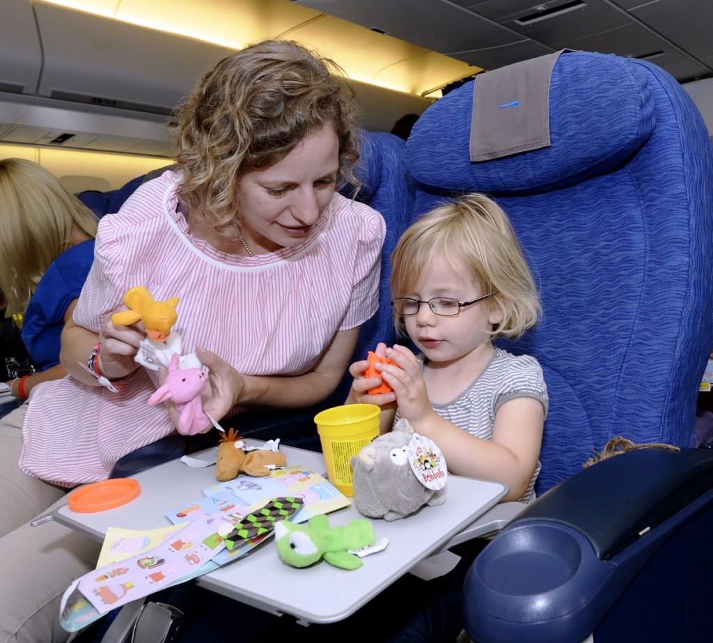 Cathy West and Elodie 2 with toys on British Airways
