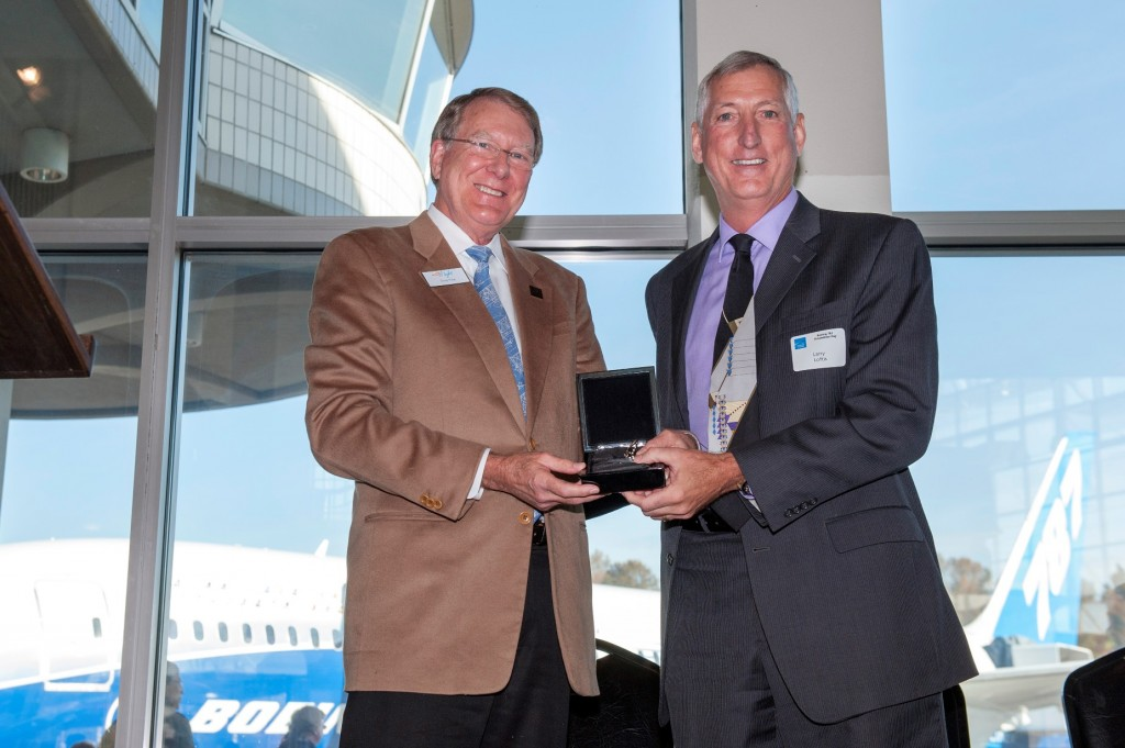 787 Vice President and General Manager Larry Loftis (right) hands the ceremonial keys over to The Museum of Flight President and CEO Doug King