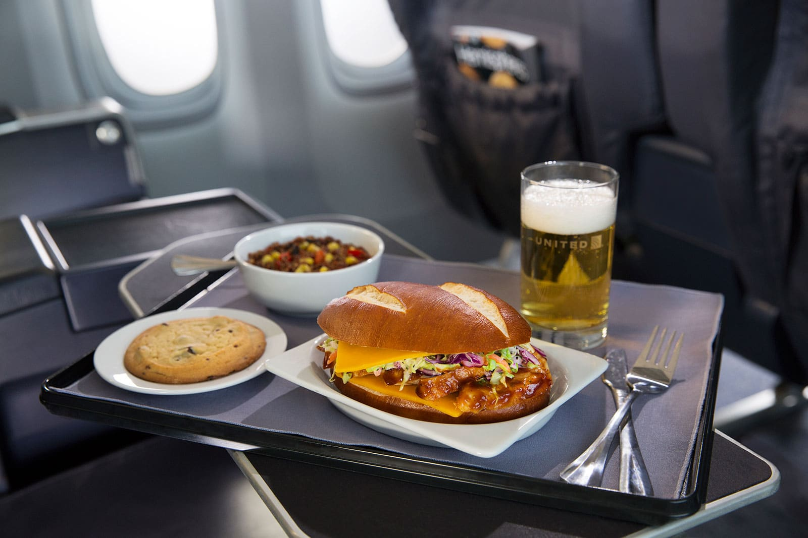 United Express Barbecue chicken on pretzel roll airline food