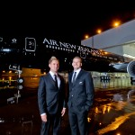 All Blacks rugby players Kieran Read and Andy Ellis outside the Boeing Painf hangar with the Black Air New Zealand 777