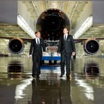 All Blacks rugby players Kieran Read and Andy Ellis with the Black Air New Zealand 777-300ER at Boeing paint hangar
