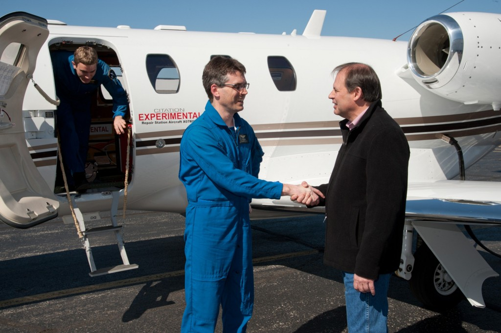 Scott Ernest, Cessna president and CEO, congratulating Cessna pilot Pete Fisher after a successful first flight of the Citation M2 prototype