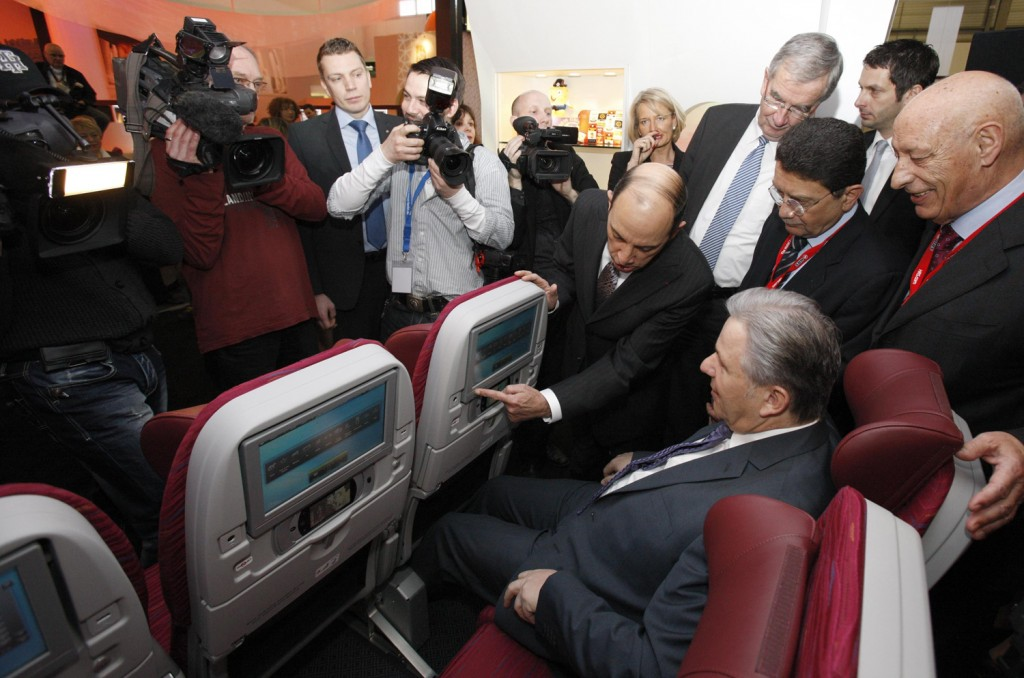 Qatar Airways CEO Akbar Al Baker demonstrates new entertainment system to The Mayor of Berlin, Klaus Wowereit on new Economy Class seats on Boeing 787 aircraft