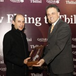 Qatar Airways CEO Akbar Al Baker exchanges a special gift with General Manager of TAV Georgia, Mr. Mete Erkal.