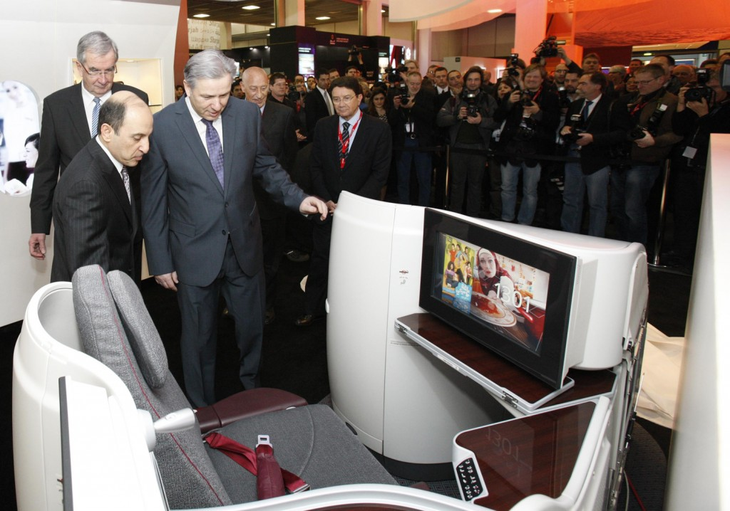 Qatar Airways Chief Executive Officer Akbar Al Baker shows Mayor of Berlin, Klaus Wowereit new Boeing 787 Business Class seat.