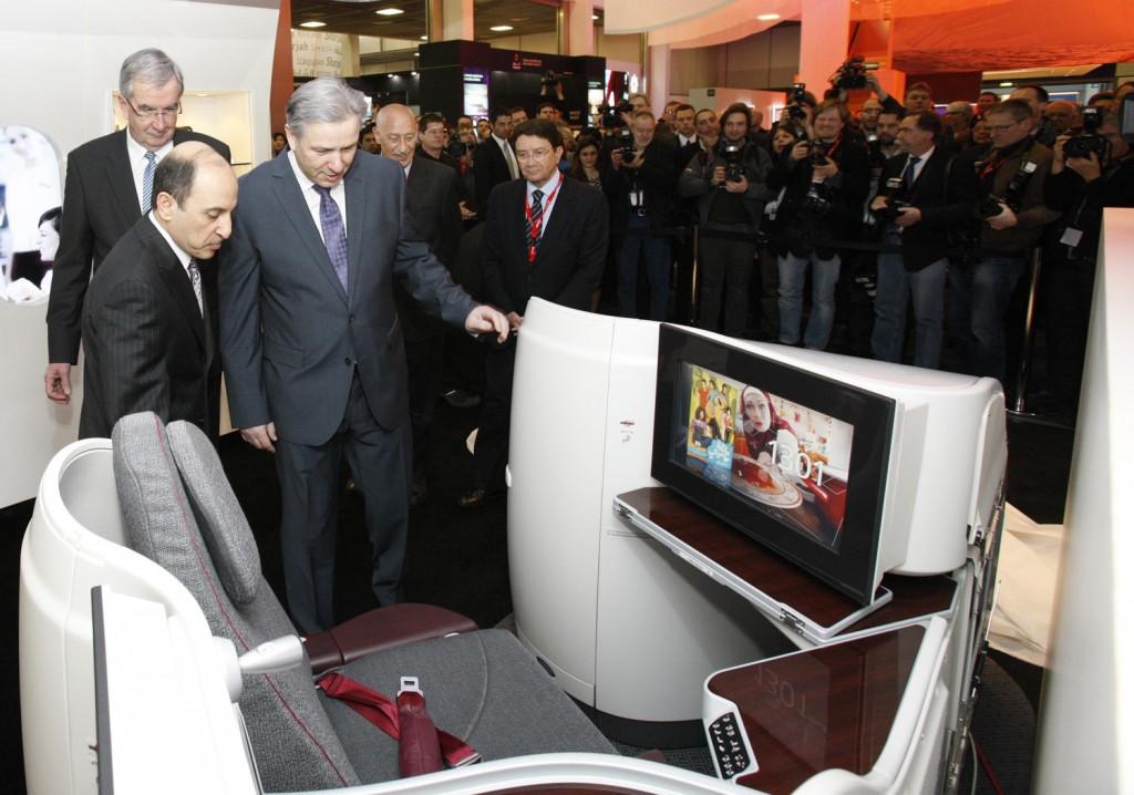Qatar Airways Chief Executive Officer Akbar Al Baker shows Mayor of Berlin, Klaus Wowereit new Boeing 787 Business Class seat.