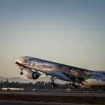The Air New Zealand Hobbit Boeing 777 begins take off at LAX