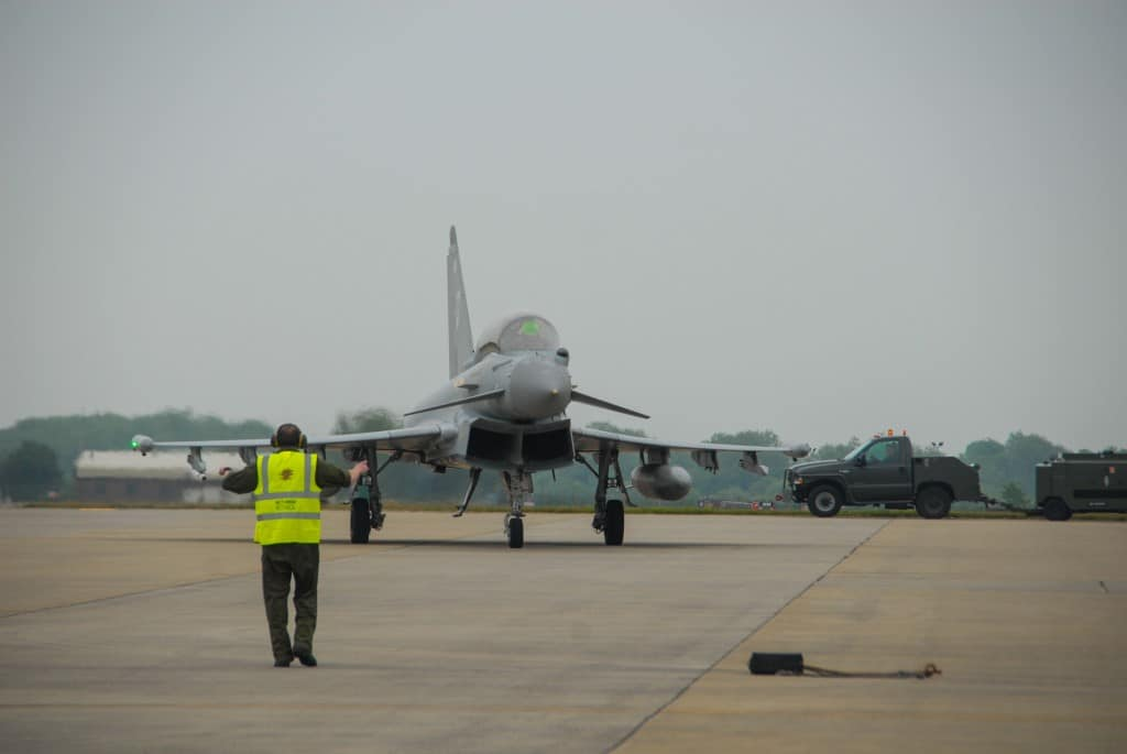 Wing Commander Richard Wells taxis the RAF Typhoon jet after arriving at RAF Fairford with Suzi Perry